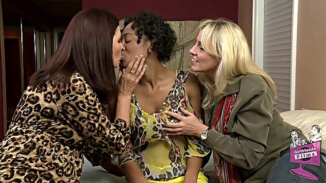 Ebony-skinned lesbian with big boobs enjoying a hardcore threesome