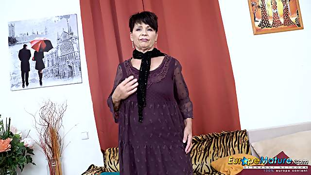 Mature lady from europe is enjoying free time solo masturbation
