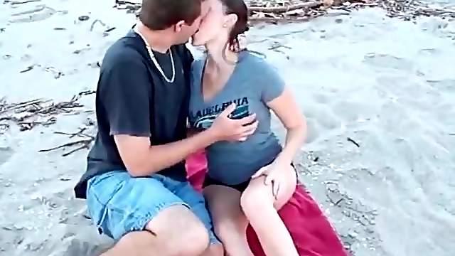 Kissing a cutie that sucks his dick on the beach