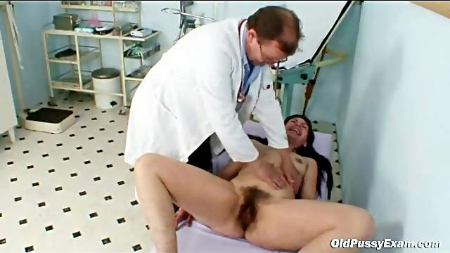Speculum pushes inside her hairy older cunt