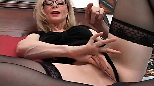 Pornstar Nina Hartley shows you her wet cunt
