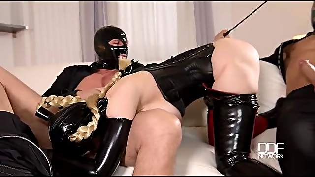 Latex fetish threesome fuck with a submissive slut