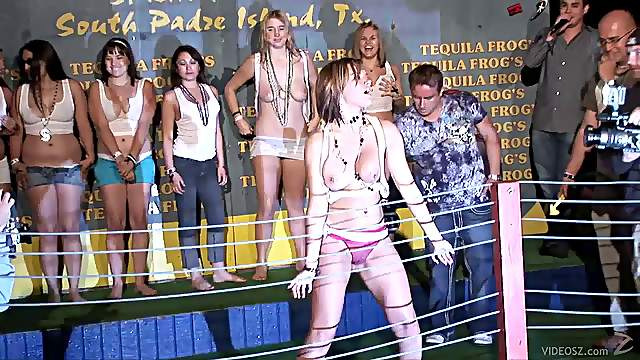 Wild party girls get topless and naked during a wet t-shirt contest