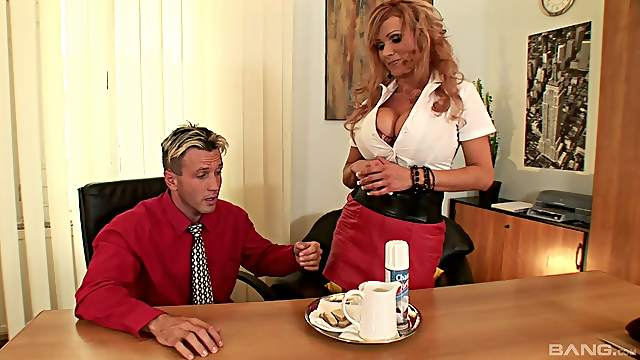 Redhead pornstar with big tits in a miniskirt getting screwed hardcore in a reality shoot at the office