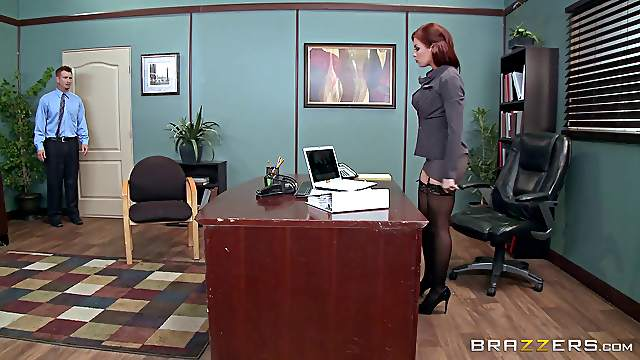Busty redhead woman in stockings gets ass fucked in the office