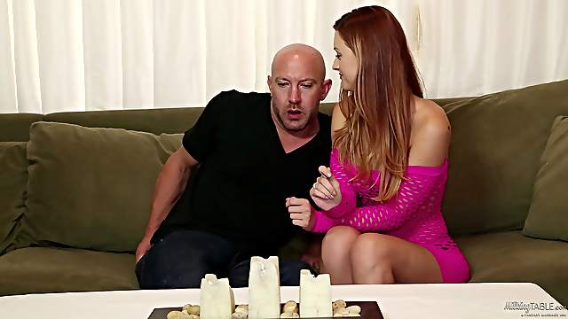 Redhead in high heels and pink top sucks cock under milking table
