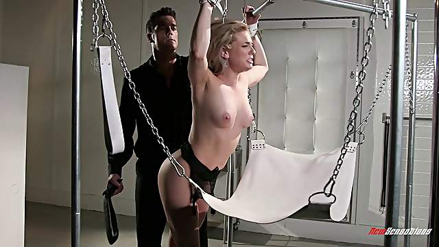 Dominate guy spanks and uses her while she's in a fuck swing