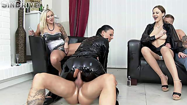 Shiny leather suit coated with oil and fucked in front of her friends