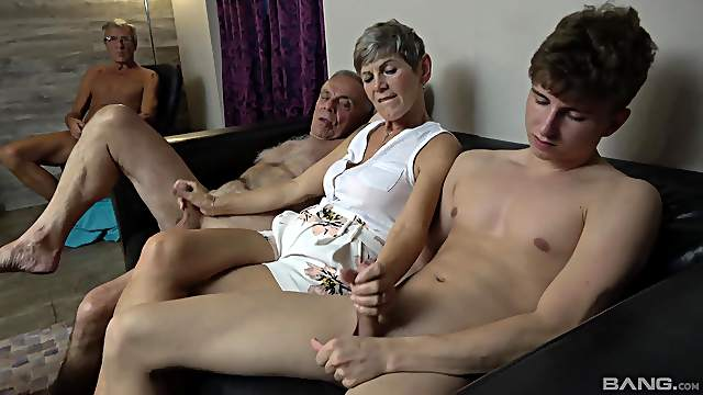 Granny strokes two dicks and a younger chick rides them both
