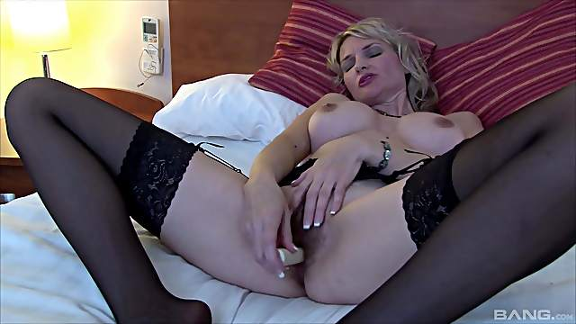 Solo mature wife in black lingerie plays with her orgasmic pussy