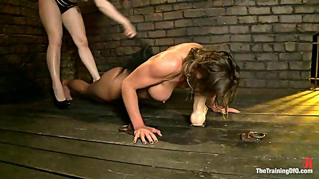 Brunette gets fucked with a strap-on by a blonde in bondage vid