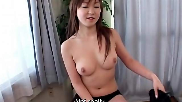 Cute Asian strips sweater and models perky tits