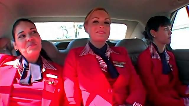 Three flight attendants strip and shake asses