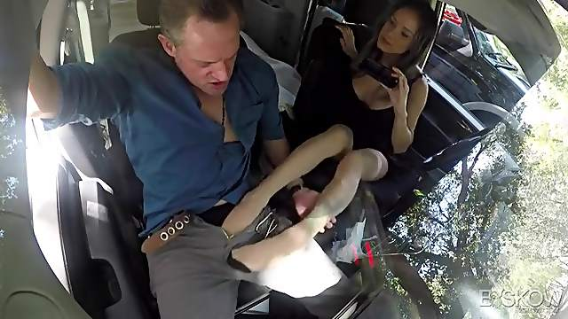 Footjob in the car from a naughty girl