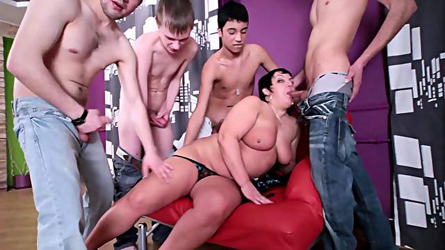 Fat mom with giant tits and gang of young poles