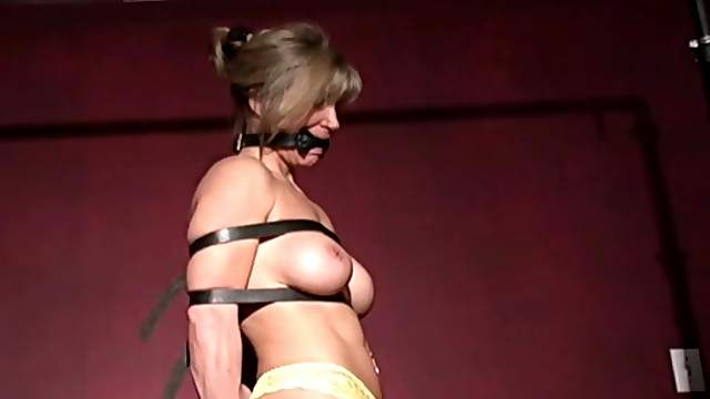 Tied and gagged blonde milf