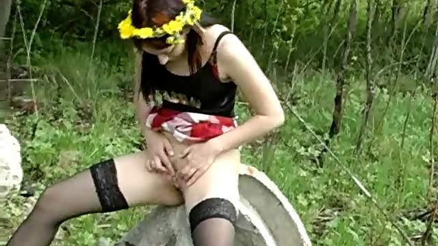 Flower girl in stockings pisses outdoors