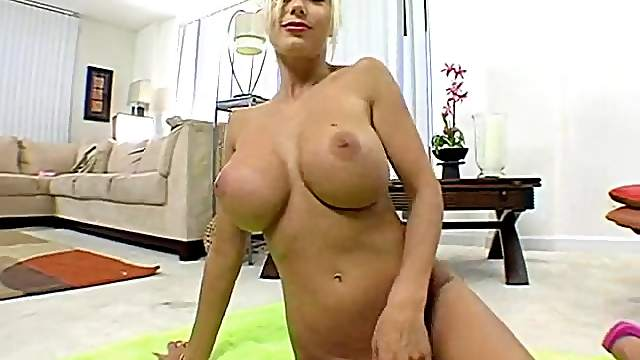 Kinky blonde shows off her big tits before jerking a guy off