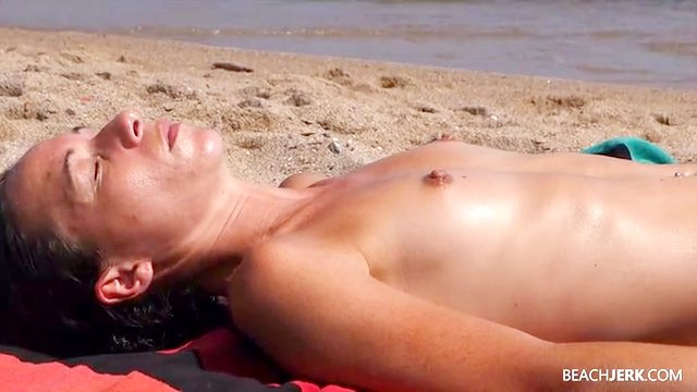 Tanning babes with perky tits at the beach
