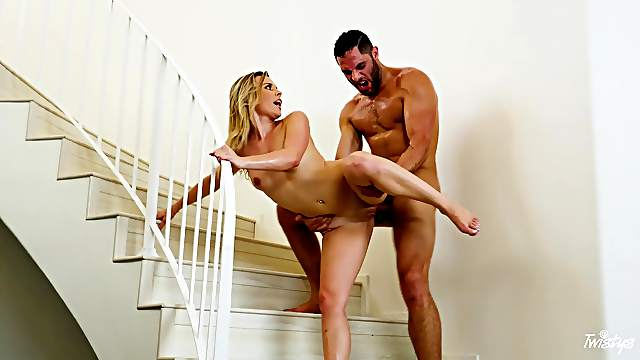 Sexy wife gets laid with a muscular hunk right on the stair case
