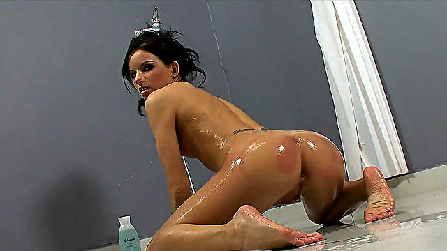 Nasty brunette loves to pose in the shower