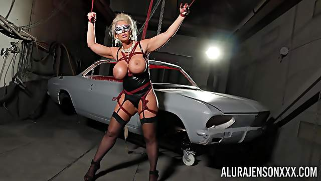 Cougar acts submissive while being restrained and exposed