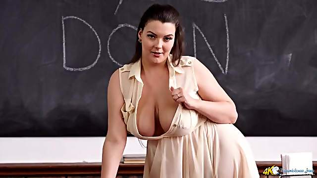 Curvy milf teacher has the sexiest cleavage